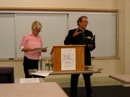 Poet Michael Davidson reading one of his poems for two voices with Jennifer Moxley