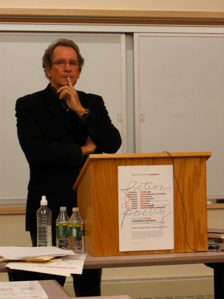 Poet Michael Davidson entertains a question from the audience after his UMaine reading
